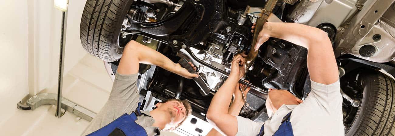 Men providing car service and repairs