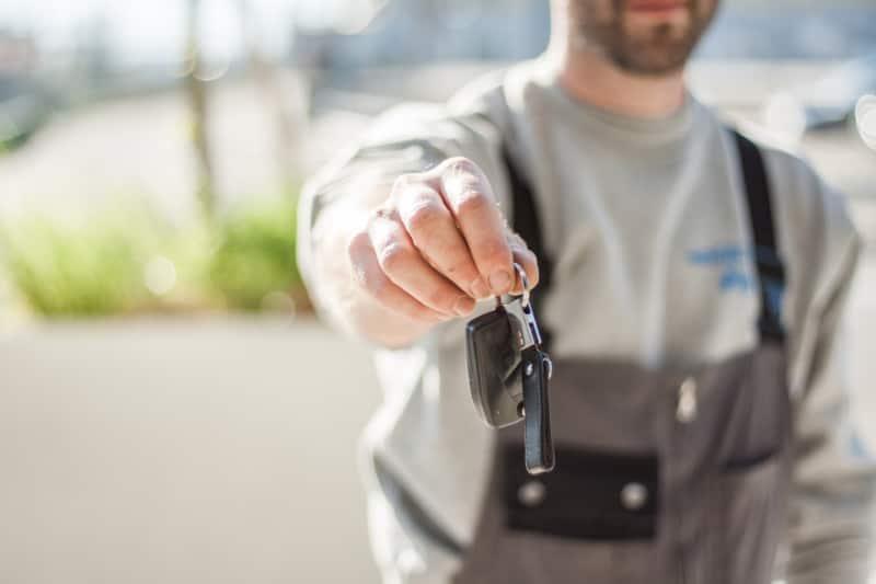 man holding a set of car keys